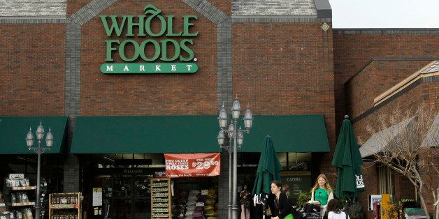 In this photo taken Sunday, Feb. 6, 2011, customers gather outside of a Little Rock, Ark., Whole Foods store. Whole Foods Market Inc. releases quarterly financial earnings Wednesday, Feb. 9, after the market close.(AP Photo/Danny Johnston)