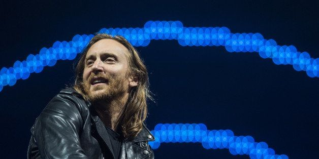 French DJ David Guetta performs on the opening day of the Rock in Rio music festival, in Rio de Janeiro, Brazil, on September 13, 2013.   AFP PHOTO / YASUYOSHI CHIBA        (Photo credit should read YASUYOSHI CHIBA/AFP/Getty Images)