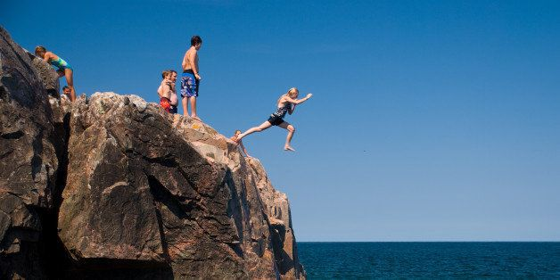 [UNVERIFIED CONTENT] A girl jumps into Lake Superior from the rocky shore of Little Presque Isle in the Upper Peninsula of Michigan.