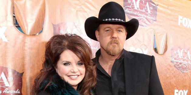 LAS VEGAS, NV - DECEMBER 05:  Host Trace Adkins (R) and Rhonda Forlaw arrive at the American Country Awards 2011 at the MGM Grand Garden Arena on December 5, 2011 in Las Vegas, Nevada.  (Photo by Christopher Polk/ACA2011/Getty Images for ACA)