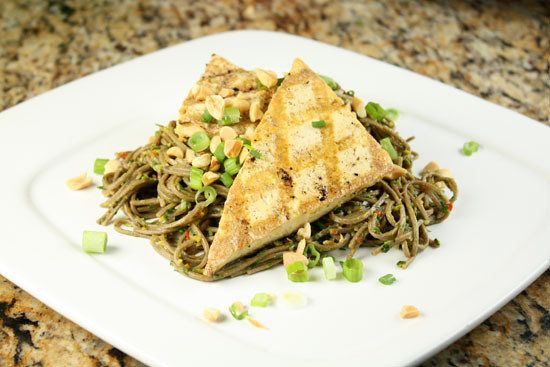 "<strong>Get the <a href=""http://www.macheesmo.com/2010/12/grilled-tofu-with-spicy-soba/"" target=""_blank"">Grilled Tofu With Sp"