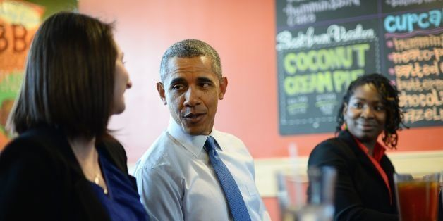 US President Barack Obama has lunch with restaurant workers at Zingerman's on April 2, 2014 in Ann Arbor, Michigan. Obama arrived in Michigan to speak on raising the national minimum wage. Obama unveiled a proposal to increase the federal minimum wage from $7.25 to $10.10 (7.35 euros) an hour in his State of the Union address in January as he set about closing income disparity -- an increasingly important theme in US politics. AFP PHOTO/Jewel Samad        (Photo credit should read JEWEL SAMAD/AFP/Getty Images)