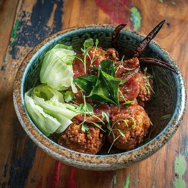 Laotian food is kind of a cross between Vietnamese and Thai, but has its own, unique sensibility. Common flavors include lime