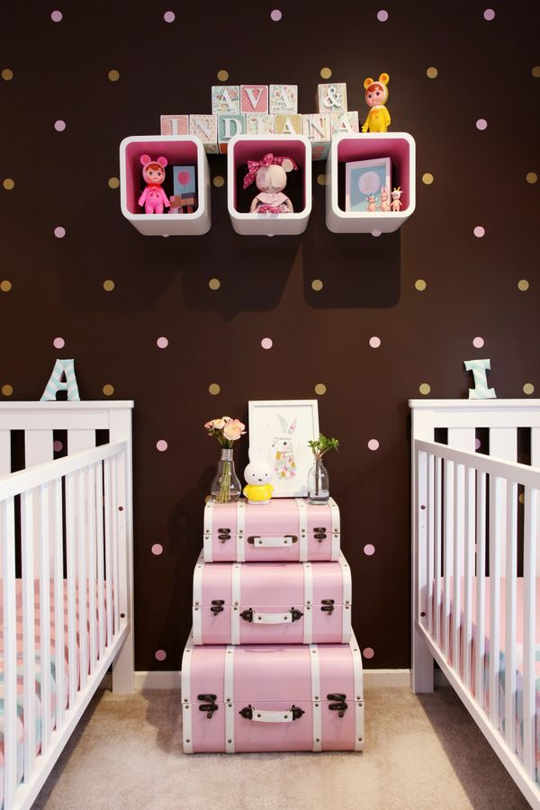 Chocolate brown stands in perfectly for the more predictable pink in this twin girls' room by designer Natalie D'Urso of <a h