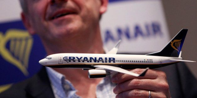 Michael O'Leary, chief executive officer of Ryanair Holdings Plc, holds a model aircraft as he speaks during a news conferenc