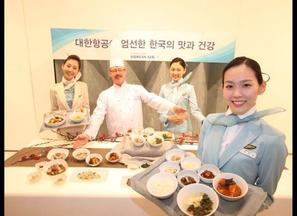 <strong>KOREAN</strong>  The Asian carrier is serving elevated Korean fare (think black rice and walnut porridge and plum d