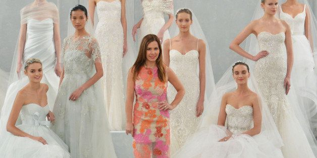 NEW YORK, NY - APRIL 11:  Designer Monique L'huillier poses with models during the Monique Lhuillier Spring 2015 Bridal collection show on April 11, 2014 in New York City.  (Photo by Slaven Vlasic/Getty Images)