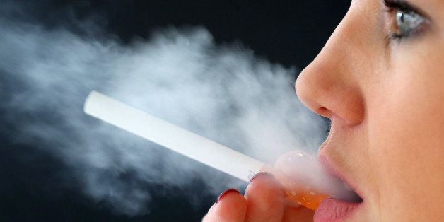 LONDON, ENGLAND - APRIL 02:  In this photo illustration a woman smokes an e-cigarette on April 2, 2014 in London, England. Wa