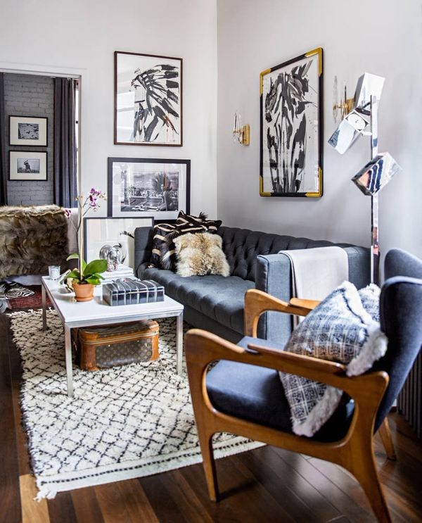 """In an open floor plan, an area rug can turn a seating arrangement into a """"room."""""""