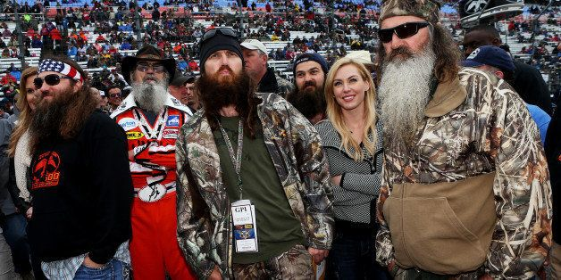 FORT WORTH, TX - APRIL 06:  (L-R) Willie, Si, Jase, Jessica and Phil Robertson take part in pre-race ceremonies for the NASCAR Sprint Cup Series Duck Commander 500 at Texas Motor Speedway on April 6, 2014 in Fort Worth, Texas.  (Photo by Sean Gardner/NASCAR via Getty Images)