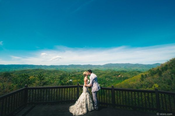 """Lindsay and Tyler look over the Smoky Mountains before their wedding yesterday at Hawkesdene House in Andrews, N.C."""