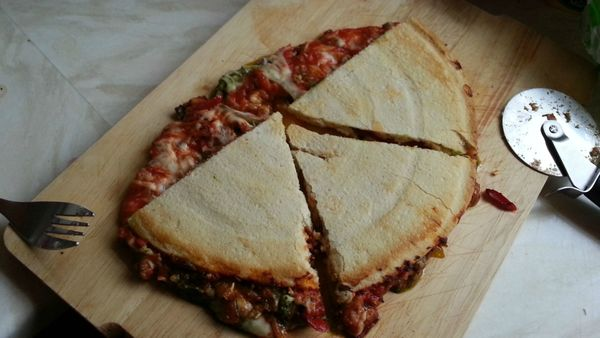 Pure genius. Frozen pizza, filled with peppers, folded in half and eaten like a quesadilla.