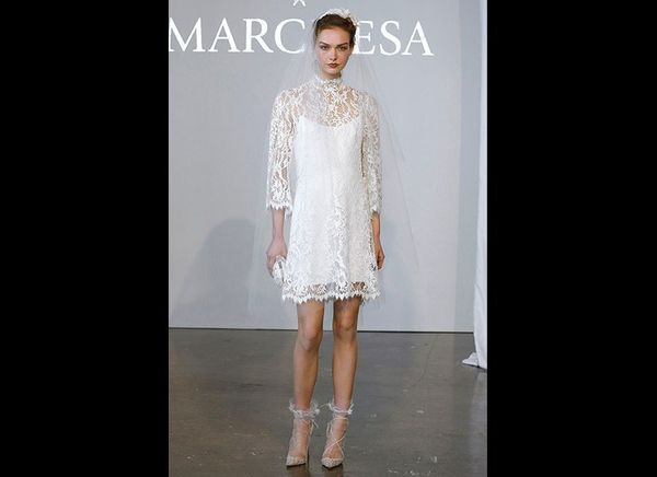 """At <a href=""""http://www.marchesa.com"""" target=""""_blank""""><strong>Marchesa</strong></a>, a mod '60s-inspired lace dress was ac"""