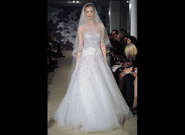 """This sheer, bedazzled ball gown and veilat<strong><a href=""""http://www.carolinaherrera.com"""" target=""""_blank"""">Caroli"""