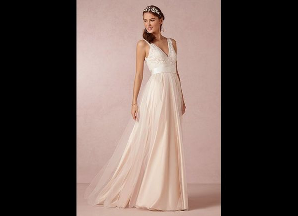 """A feminine floral headband paired beautifully with this A-line gown by <a href=""""http://www.bhldn.com"""" target=""""_blank""""><strong"""
