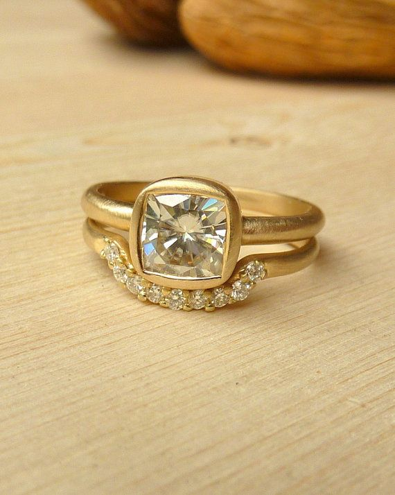 "<em>Cushion cut moissanite ring and diamond fitted band from <a href=""http://r.lover.ly/redir.php/M7mktIYi9lI_aHR0cDovL3d3dy5"