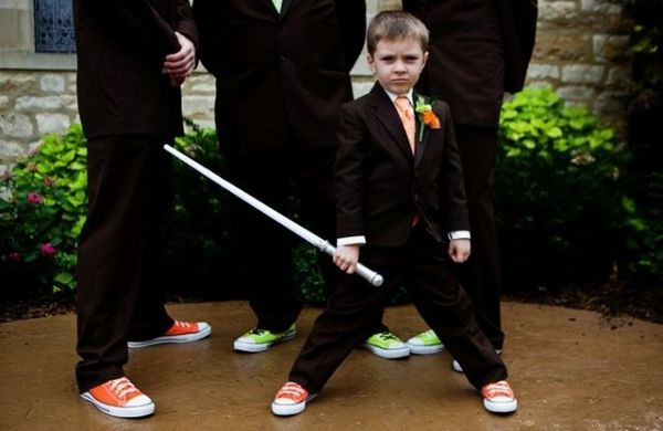 This pint-sized wedding guest got to have a pretty awesome Luke Skywalker moment with a light saber!