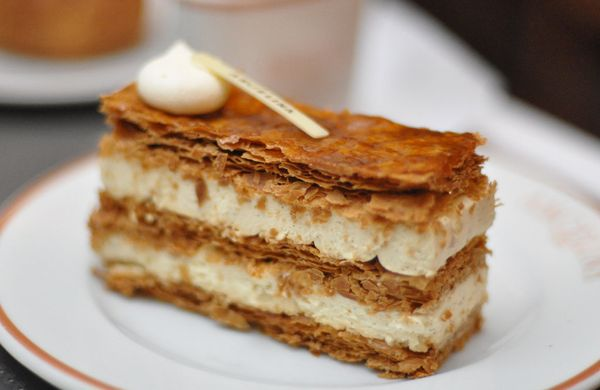 Mille feuille, which means thousand leaves in French, is appropriately named for its flaky layers of puff pastry.