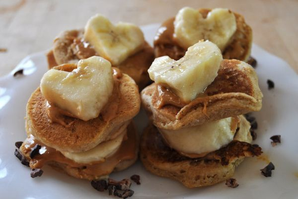"""<strong>Get the <a href=""""http://thecolorfulkitchen.com/2014/02/09/vegan-valentines-day-pb-pancake-sandwiches-banana-hearts/"""""""