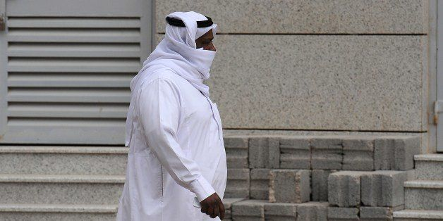 A Saudi man covers his mouth and nose while he walks down a main street in the Saudi capital on April 29, 2014 as the death toll from the newly emerged and often fatal Middle East Respiratory Syndrome (MERS) disease topped 100 in the desert kingdom. The health ministry reported more MERS cases in the city of Jeddah, prompting authorities to close the emergency department at the city's King Fahd Hospital. AFP PHOTO/FAYEZ NURELDINE        (Photo credit should read FAYEZ NURELDINE/AFP/Getty Images)