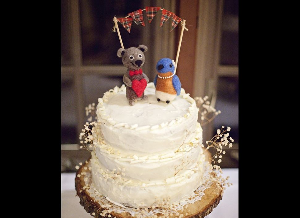 "<em>More from The Knot: </em><a href=""http://www.theknot.com/weddings/photos/cake-toppers/cake?cm_mmc=TK-_-HuffingtonPost-_-R"