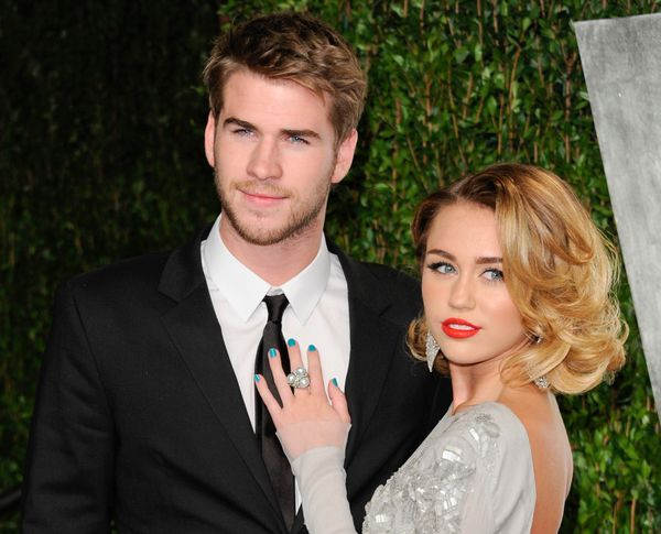 Pictured: Miley Cyrus, right, and Liam Hemsworth