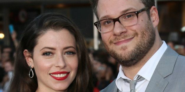 WESTWOOD, CA - APRIL 28:  Actor Seth Rogen (R) and wife Lauren Miller attend the premiere of Universal Pictures' 'Neighbors' at Regency Village Theatre on April 28, 2014 in Westwood, California.  (Photo by David Livingston/Getty Images)