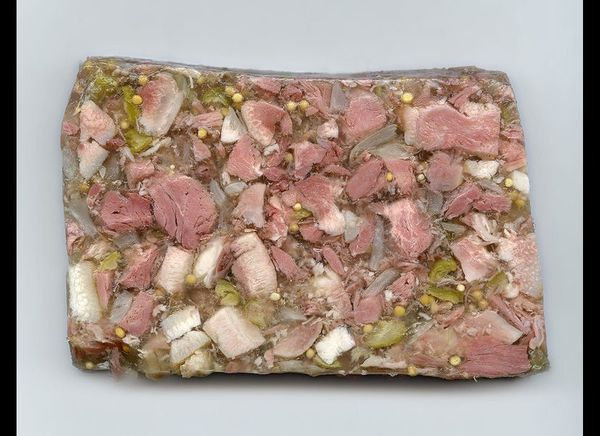 Head cheese looks like chunks of meat from a pig's face, set in aspic and molded in a terrine…which is EXACTLY WHAT IT IS.