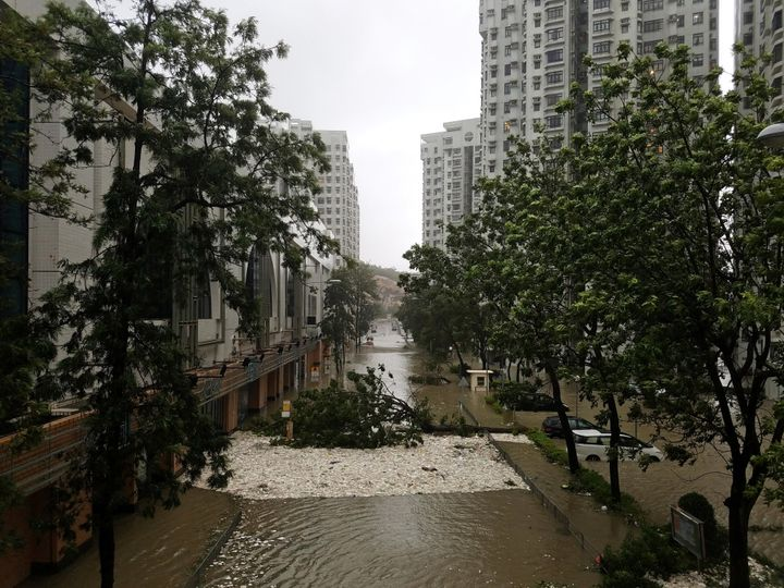 Foam brought by high waves is seen washed ashore in Heng Fa Chuen, a residential area near Hong Kong's waterfront, durin