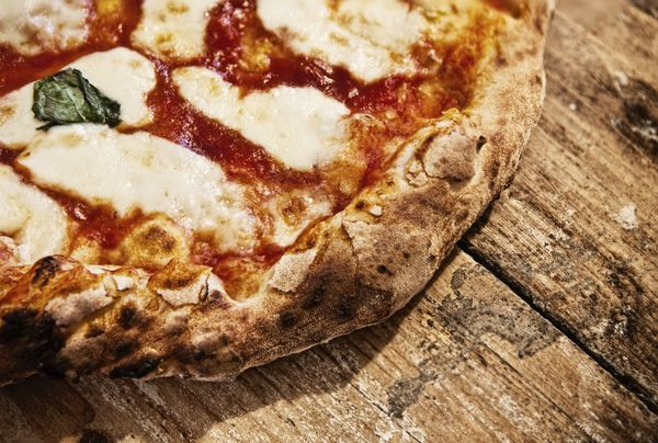 Regular, shredded mozzarella is the standard-bearer on pies both in Italy and the U.S. However, Gemignani says, Italian chefs