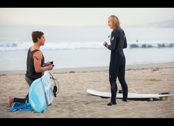 This adorable proposal, which happened on Thanksgiving day, was intimate and personal for ocean-lovers Rob and Jess. Surfing