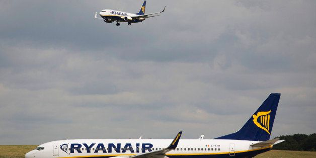 A passenger aircraft operated by Ryanair Holdings Plc comes into land as one aircraft waits to depart from Stansted Airport, operated by Manchester Airports Group (MAG) in Stansted, U.K., on Tuesday, Sept. 10, 2013. From two planes in 1995, EasyJet has grown to more than 200 Airbus SAS aircraft carrying more than 59 million people annually, 20 million fewer than Ryanair. Photographer: Simon Dawson/Bloomberg via Getty Images