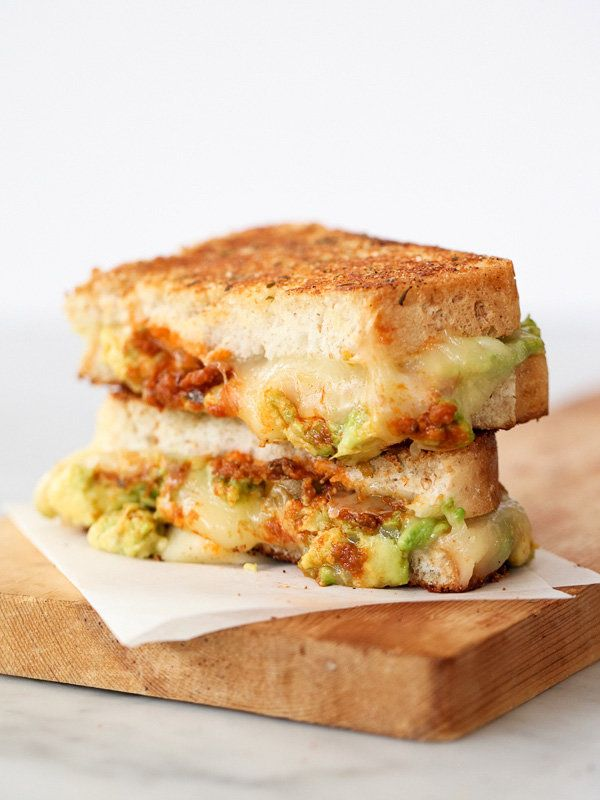 """<strong>Get the <a href=""""http://www.foodiecrush.com/2014/03/garlicky-avocado-grilled-cheese-with-tomato-pesto/"""" target=""""_blan"""