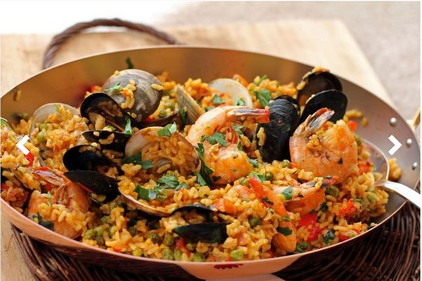 """<strong>Get the <a href=""""https://food52.com/recipes/7222-spicy-andalusian-seafood-paella"""" target=""""_blank"""">Spicy Andalusian Se"""