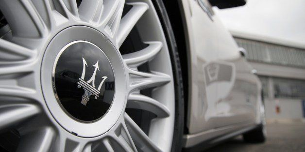The logo of Italian luxury car manufacturer Maserati is seen on the front wheel of a Maserati Quattroporte outside a Maserati plant on May 22, 2014 in Grugliasco, near Turin. The plant was renamed after late Italian President of carmaker Fiat, Gianni Agnelli. AFP PHOTO / MARCO BERTORELLO        (Photo credit should read MARCO BERTORELLO/AFP/Getty Images)