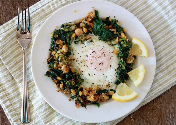 "<strong>13 grams of protein</strong><br><a href=""http://www.kitchentreaty.com/lemony-egg-in-a-spinach-chickpea-nest/"">Get the"