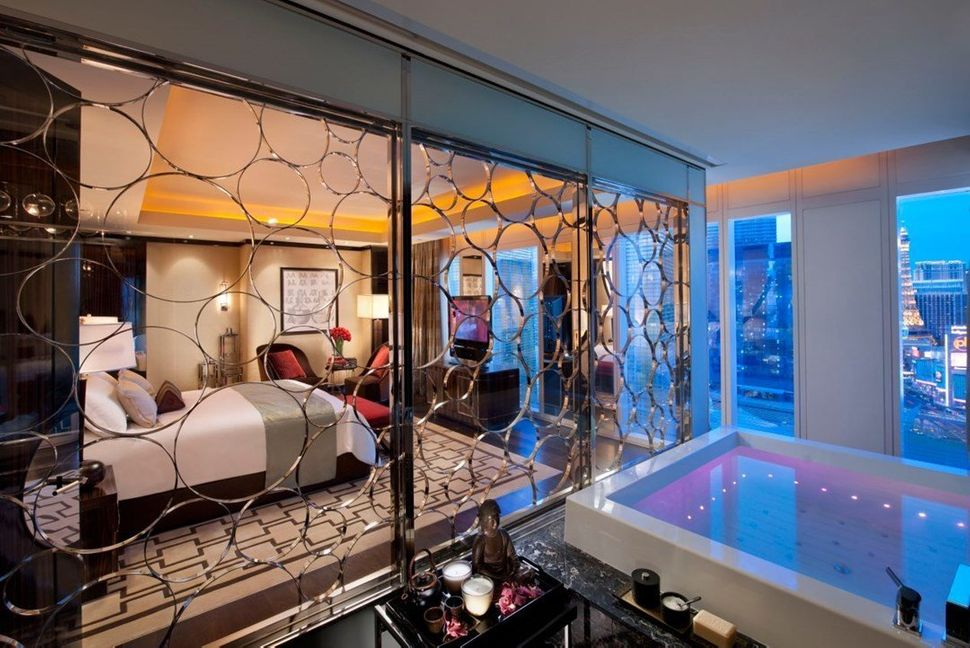 Amenities at the Mandarin Oriental, Las Vegas include a flatscreen TV and a tub that could be mistaken for a swimming pool.