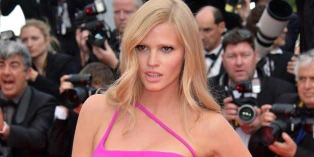 Dutch model Lara Stone poses as she arrives for the screening of the film 'The Search' at the 67th edition of the Cannes Film Festival in Cannes, southern France, on May 21, 2014.         AFP PHOTO / ALBERTO PIZZOLI        (Photo credit should read ALBERTO PIZZOLI/AFP/Getty Images)