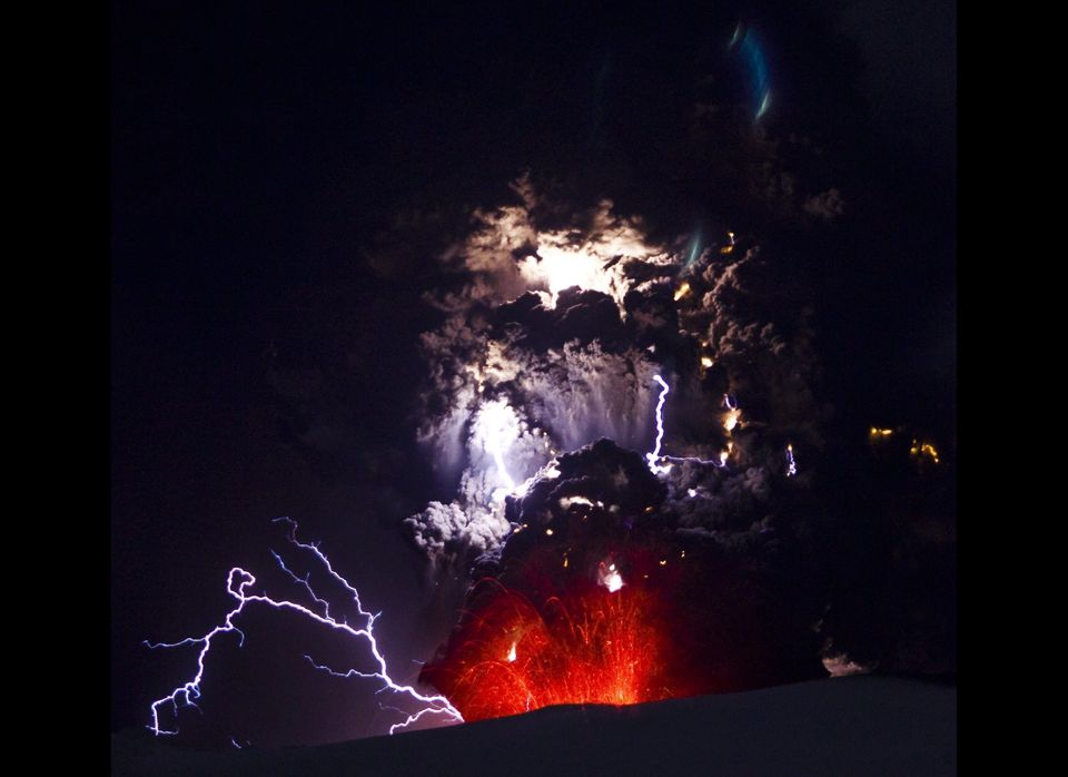 Lightning is seen within a cloud of volcanic matter as it rises from Eyjafjallajokull volcano April 18, 2010 Eyjafjallajokull