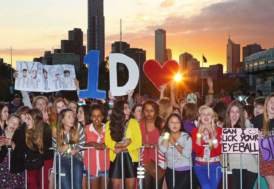 MELBOURNE, AUSTRALIA - APRIL 16:  Fans wait for the gates to open outside of the One Direction concert at Hisense Arena on Ap