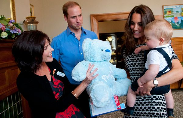 Meanwhile, doting dad Prince William kept it business casual in a powder blue button-down shirt and navy slacks.