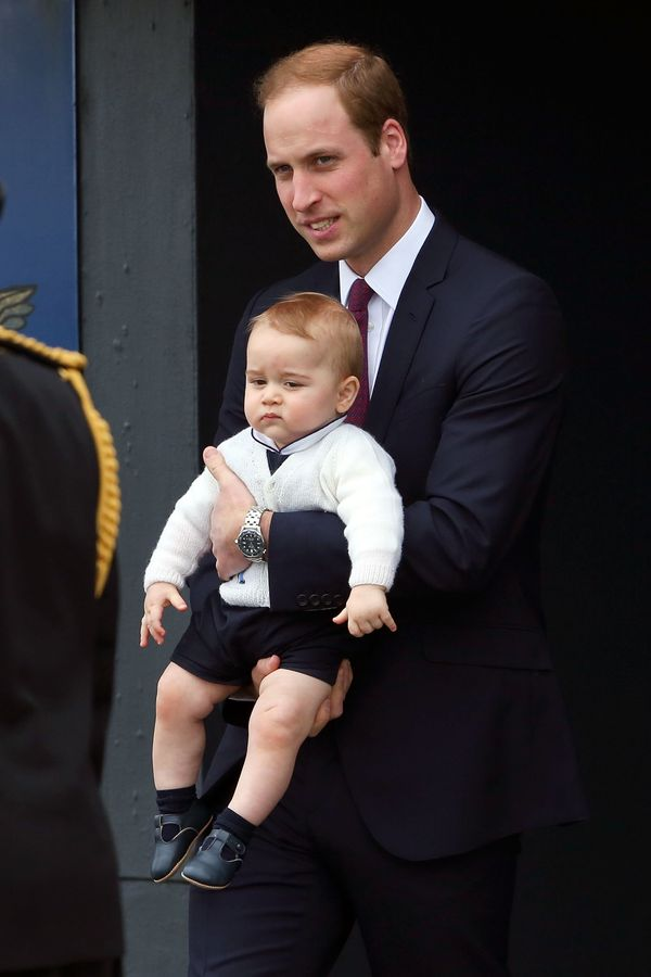 When he gave someone a serious side-eye while resting cozy in his father's arms. Prince George's adorable navy and white outf