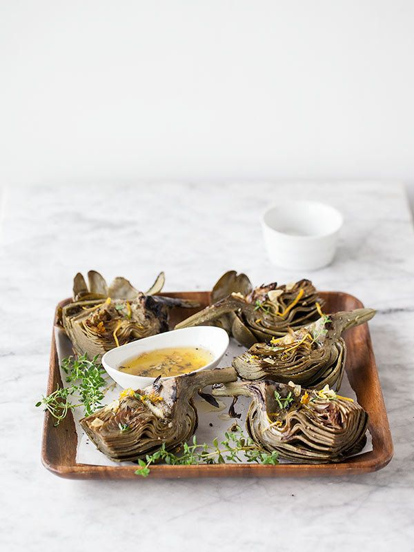 "<strong>Get the <a href=""http://www.foodiecrush.com/2013/05/grilled-artichokes-with-garlic-butter-and-friday-faves/"" target="""
