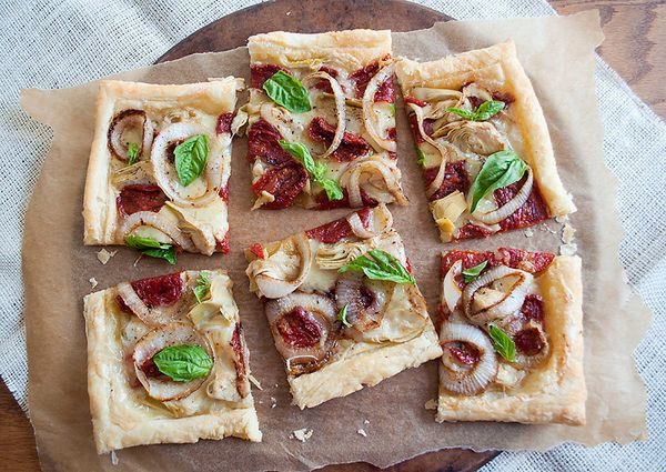 "<strong>Get the <a href=""http://food52.com/recipes/16242-sun-dried-tomato-artichoke-and-goat-s-milk-brie-tart"" target=""_blank"