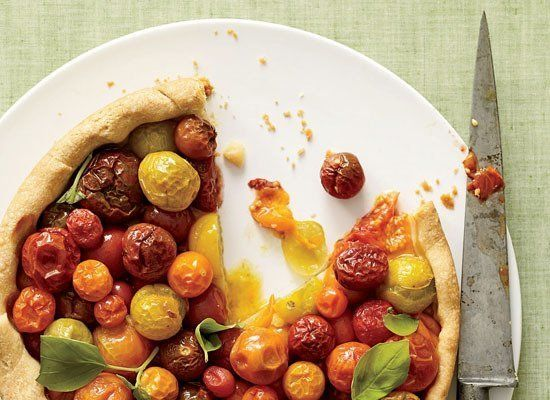 "<strong>Get the <a href=""http://www.huffingtonpost.com/2011/10/27/cherry-tomato-tart-with-b_n_1058286.html"" target=""_hplink"">"