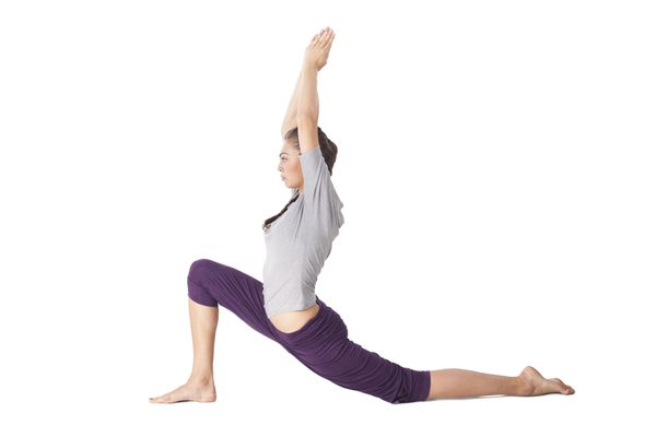 To get into the low lunge, put one foot forward and lunge so that the front knee is over the front ankle and the back knee is