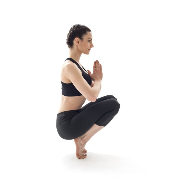 Also called the Garland Pose, the squat in yoga isn't all that different from the one you've done at the gym, form-wise. To g