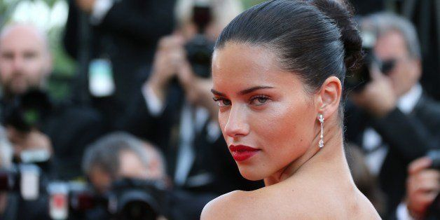 Brazilian model Adriana Lima poses as she arrives for the screening of the film 'The Homesman' at the 67th edition of the Cannes Film Festival in Cannes, southern France, on May 18, 2014.     AFP PHOTO / LOIC VENANCE        (Photo credit should read LOIC VENANCE/AFP/Getty Images)