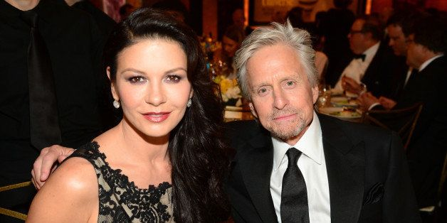 HOLLYWOOD, CA - JUNE 05:  Actors Catherine Zeta-Jones (L) and Michael Douglas attend the 2014 AFI Life Achievement Award: A T