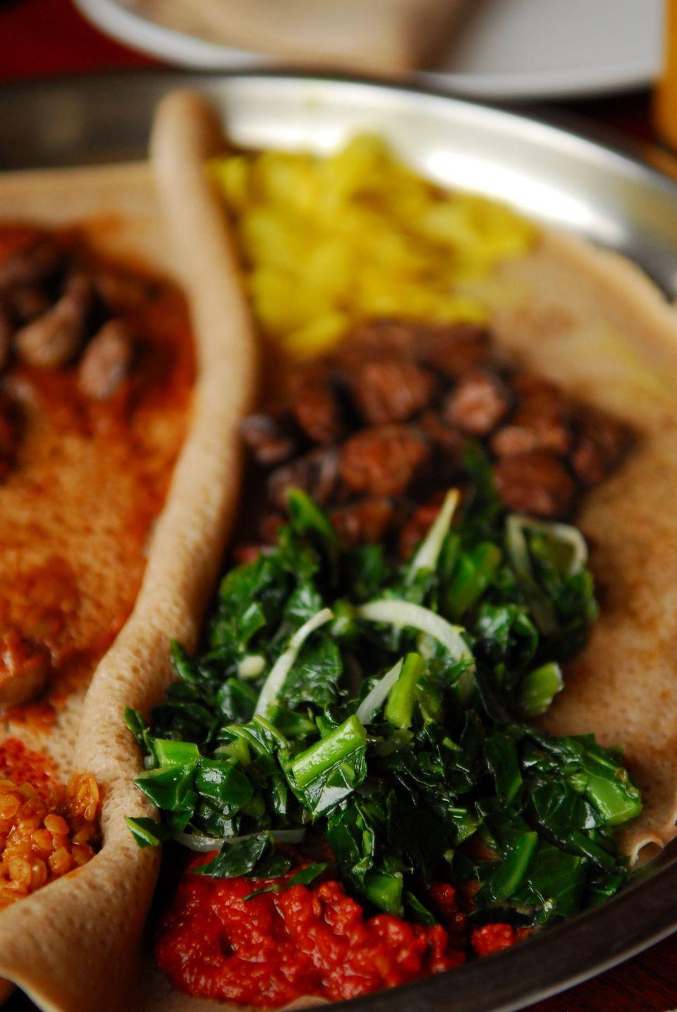 """<em><a href=""""http://www.yelp.com/biz/assab-eritrean-restaurant-san-francisco"""">Assab Eritrean Restaurant, 2845 Geary Blvd.</a>"""